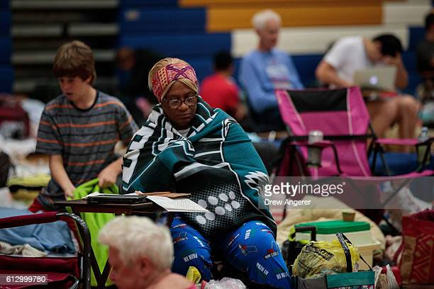 People take shelter at Mainland High School October 6 2016 in Jacksonville Florida With Hurricane Matthew approaching the Atlantic coast of the...