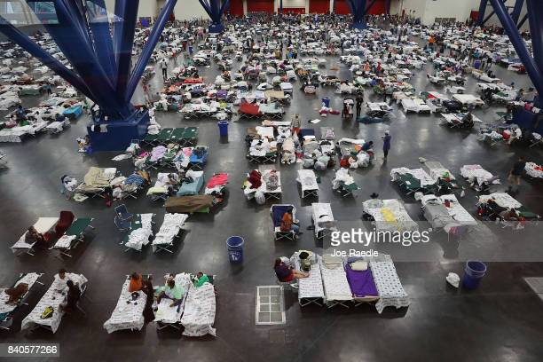 People take shelter at the George R. Brown Convention Center after flood waters from Hurricane Harvey inundated the city on August 29, 2017 in...