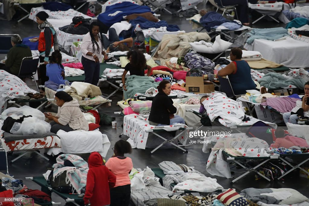 People take shelter at the George R. Brown Convention Center after flood waters from Hurricane Harvey inundated the city on August 29, 2017 in Houston, Texas. The evacuation center which is overcapacity has already received more than 9,000 evacuees with more arriving.