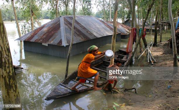 People take shelter beside the road following heavy monsoon rains at a flood affected area in Tangail Over million people have been affected by...