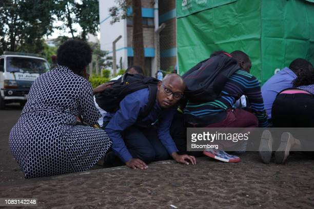 People take shelter during an attack at the 14 Riverside Drive hotel and office complex in the Westlands district of Nairobi Kenya on Tuesday Jan 15...