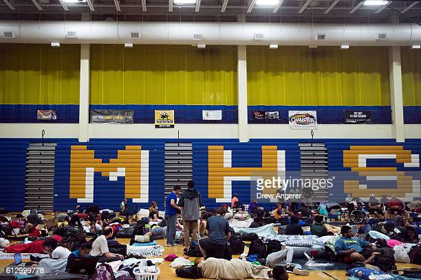 People take shelter from Hurricane Matthew at Mainland High School October 6 2016 in Jacksonville Florida With Hurricane Matthew approaching the...
