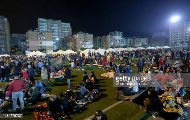 People take shelter in a camp at the soccer stadium in Durres on November 26 after the strongest earthquake in decades claimed at least 20 lives,...