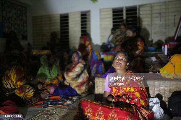People take sheltered at a temporary cyclone shelter at Dakop in Khulna as Cyclone Fani approaching towards Bangladesh on May 3 2019 At least eight...