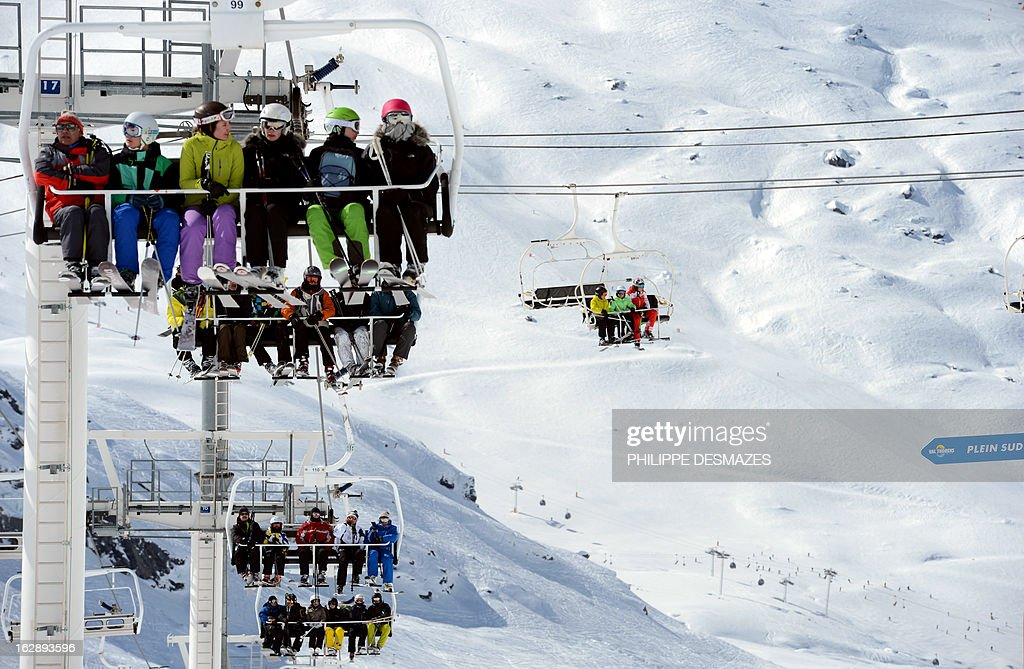 People take ski lifts at the French ski resort of Val Thorens in the French Alps on February 28, 2013.