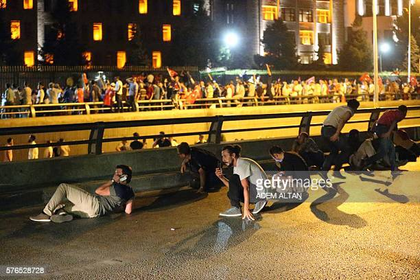 People take streets in Ankara, Turkey during a protest against military coup on July 16, 2016. Turkish military forces on July 16 opened fire on...