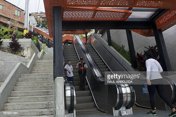 People take the escalators at Comuna 13 neighbourhood one of the poorest and most violent areas of the northeastern Colombian city of Medellin...