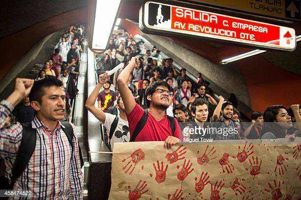 People take the subway facilities during a demonstration to ask for justice for the 43 missing students from Ayotzinapa in Mexican state of Guerrero...