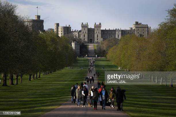 People take their daily excercise along The Long Walk in Windsor, west of London on April 10 two days day after Britain's Prince Philip, Duke of...