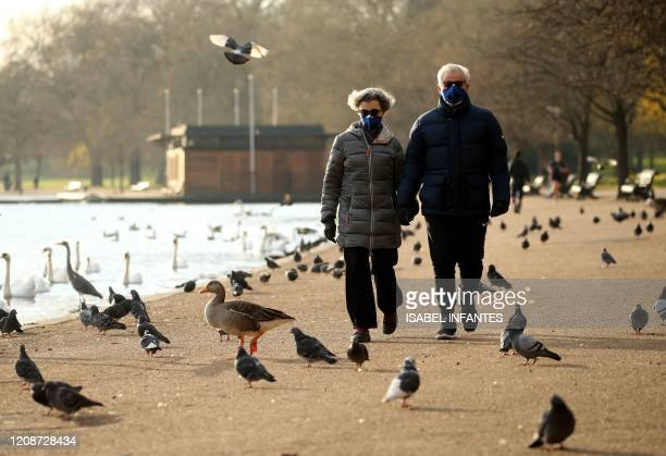People take their daily excercise in Hyde Park in central London on March 31 as life in Britain continues during the nationwide lockdown to combat...