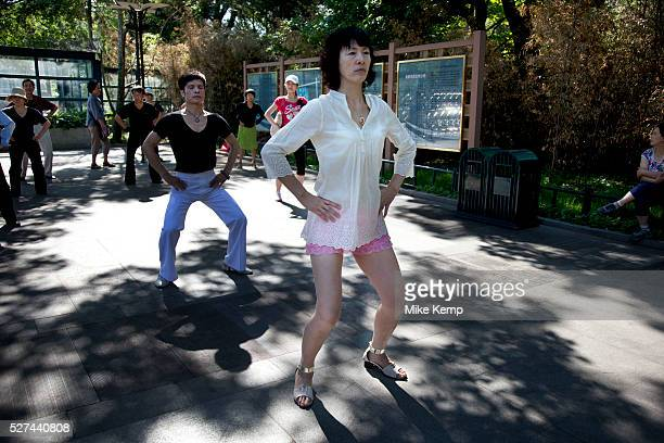 People take their morning ballroom dance exercise in Zizhuyuan Park in Beijing China This park is well known as a place where middle aged or elderly...