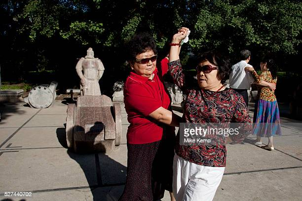 People take their morning exercise by ballroom dancing in Zizhuyuan Park in Beijing China This park is well known as a place where middle aged or...