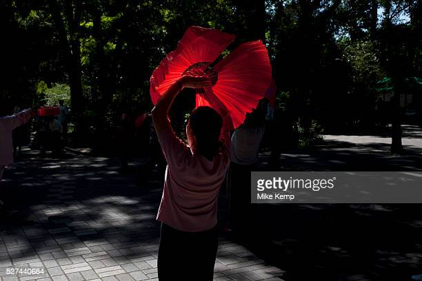People take their morning exercise fan dancing in Zizhuyuan Park in Beijing China This park is well known as a place where middle aged or elderly...