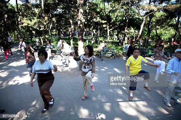 People take their morning exercise of tai chi in Zizhuyuan Park in Beijing China This park is well known as a place where middle aged or elderly...
