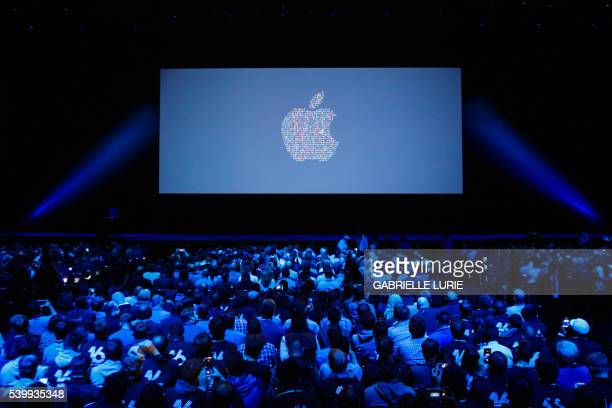 People take their seats ahead of Apple's annual Worldwide Developers Conference presentation at the Bill Graham Civic Auditorium in San Francisco...