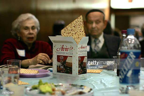 People take their seats around the table for a meal in advance of Passover March 29 2007 in New York City Jews around the world will celebrate the...