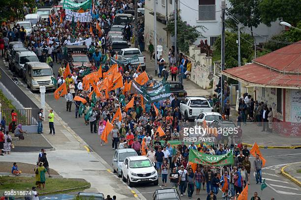 People take to the streets on September 1 2016 in Noumea during a demonstration organised by the trade union confederation Vie chere to demand the...