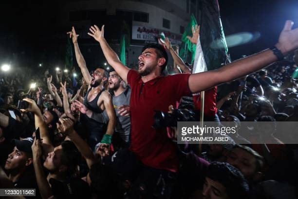 People take to the streets to celebrate following a ceasefire brokered by Egypt between Israel and the ruling Islamist movement Hamas in the Gaza...