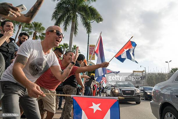 People take to the streets to react to the news of the death of former Cuban President Fidel Castro outside the restaurant Versailles November 26...