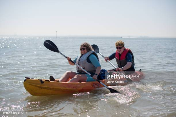 People take to the water in a kayak on March 30, 2021 in Southend, United Kingdom. Despite todays temperature heading towards 24 degrees, next week...