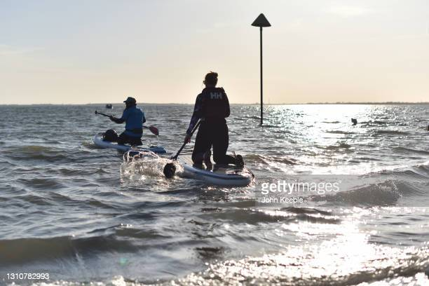 People take to the water on paddle boards on a warm sunny Easter Sunday at Chalkwell beach on April 04, 2021 in Southend-on-Sea, England. Earlier...