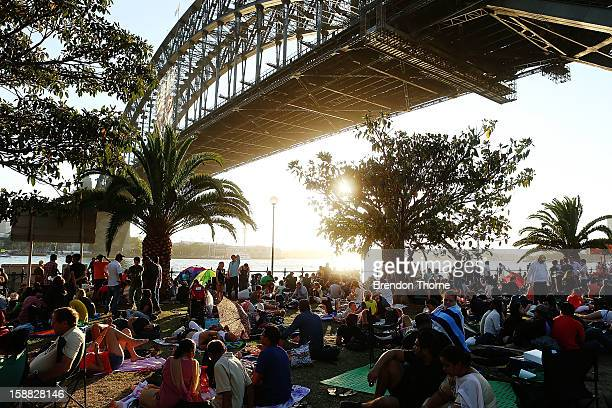 People take up position under The Sydney Harbour Bridge in anticipation of New Years Eve celebrations on Sydney Harbour on December 31 2012 in Sydney...
