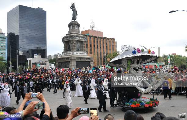 People taken part in a Day of the Dead parade in Mexico City on October 27 2018