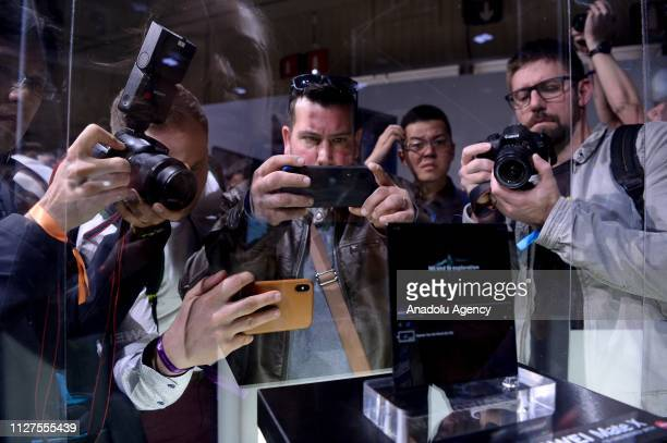 People takes pictures of Huawei's new foldable 5G smartphone MateBook X Pro at the second day of Mobile World Congress 2019 in Barcelona Spain on...