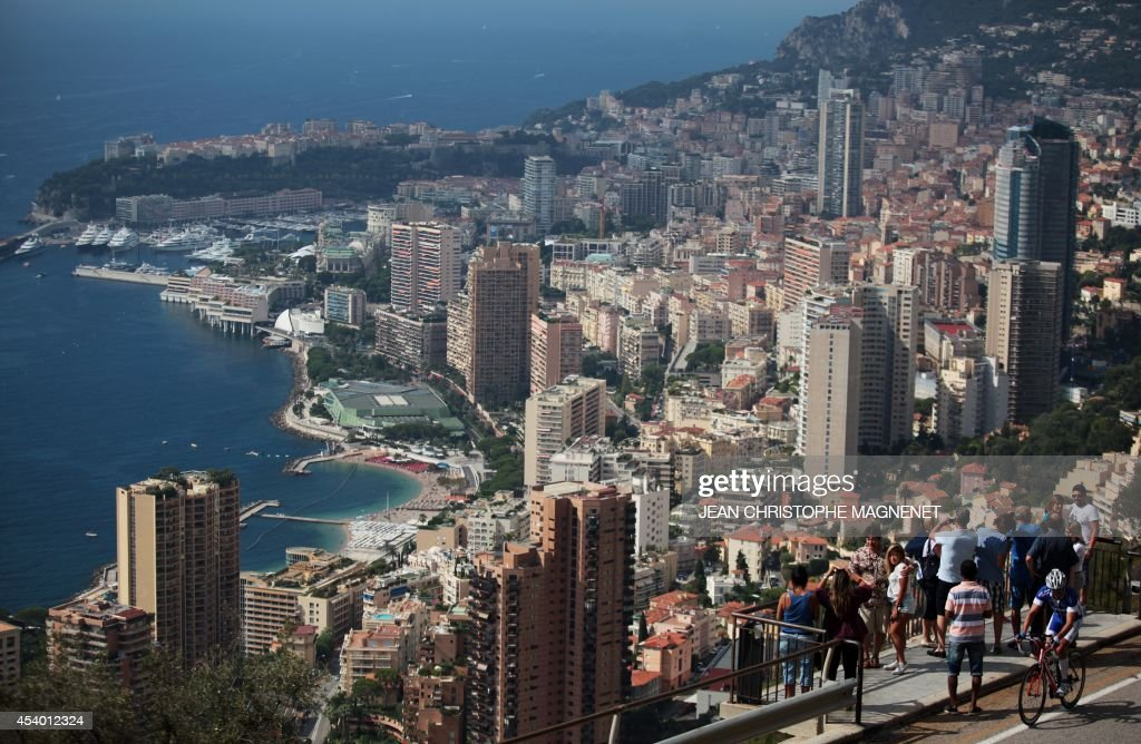 People takes pictures of Monaco, on August 23, 2014, in Roquebrune-Cap-Martin, southeastern France.