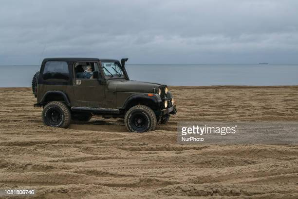 People taking a paid charity ride in Jeep Wrangler during the military picnic to support WOSP on the Baltic Sea coast are sen in Sopot Poland on 13...