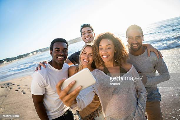 People taking a selfie at the beach