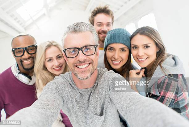 People taking a selfie at the office