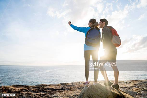 People taking a selfie while hiking