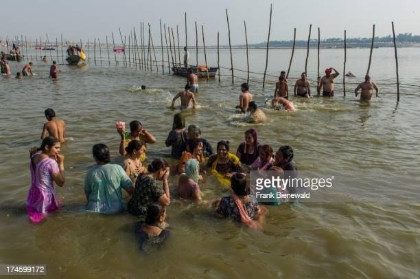 People taking bath at the Sangam the confluence of the rivers Ganges Yamuna and Saraswati at Kumbha Mela