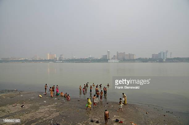 People taking bath in the river Hooghly Kolkata on the opposite side