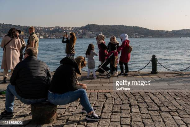 People taking photos at the seaside in Istanbul, Turkey seen on February 26, 2021. As part of the measures against the spreading of COVID-19,...