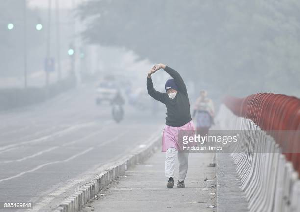 People taking precautions against cold weather and smog in morning at Vasant Kunj on December 4 2017 in New Delhi India Air quality remained very...