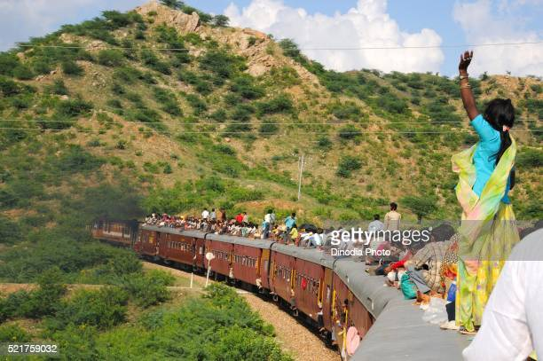 People taking risk while travelling on roof of train, Goram ghat, Marwar Junction, Rajasthan, India