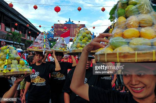 People taking ritual offerings, called Gunungan , during Lunar Chinese New Year Parade in Solo. The ritual offerings will be given to all citizens...