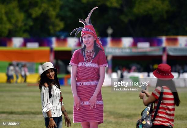 People taking selfies with cutout of a lady during the North East Calling festival at India Gate on September 9 2017 in New Delhi India The twoday...
