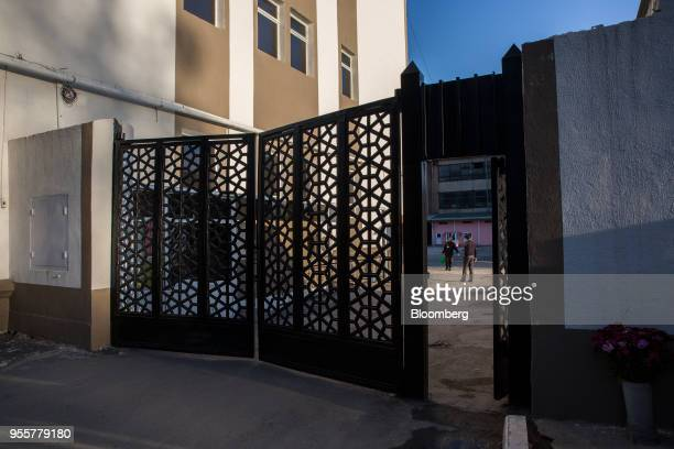 People talk in a courtyard beyond a gate in Dushanbe Tajikistan on Saturday April 21 2018 Flung into independence after the Soviet Union collapsed in...