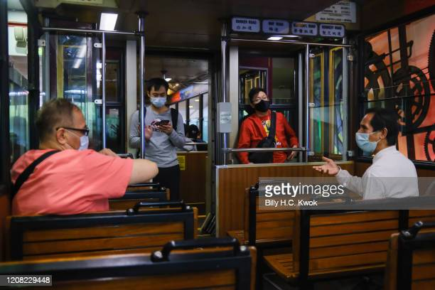 People talk in a peak tram during a coronavirus outbreak on March 26 2020 in Hong Kong China Latest statistics showed Hong Kong tourist arrivals...