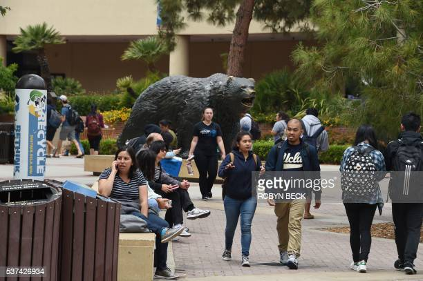 People talk on the phone at the University of California Los Angeles campus after a shooting on the facility June 1 in Los Angeles California Two...