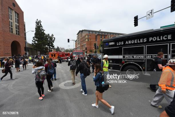 People talk on the phone on the University of California Los Angeles campus after a shooting on the facility June 1 in Los Angeles California Two...