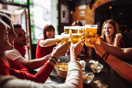 people talking and toasting in a pub with the beers 1091469178