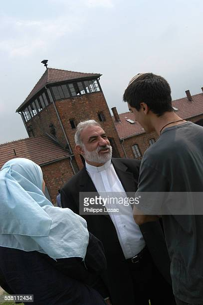 people talking at auschwitz ii-birkenau - auschwitz concentration camp stock pictures, royalty-free photos & images