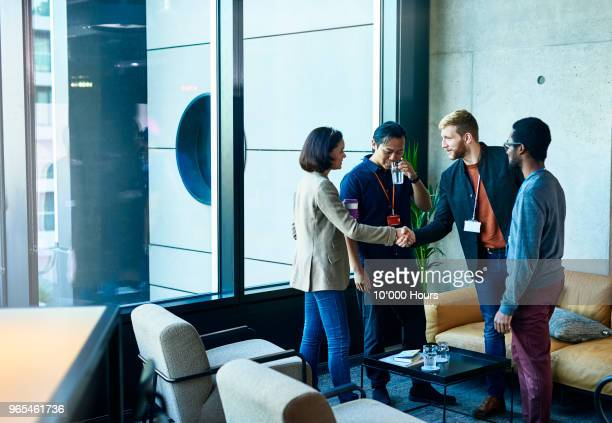 people talking in office - greeting stock pictures, royalty-free photos & images