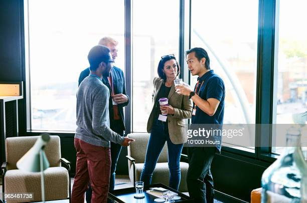 people talking in office - business relationship stock pictures, royalty-free photos & images