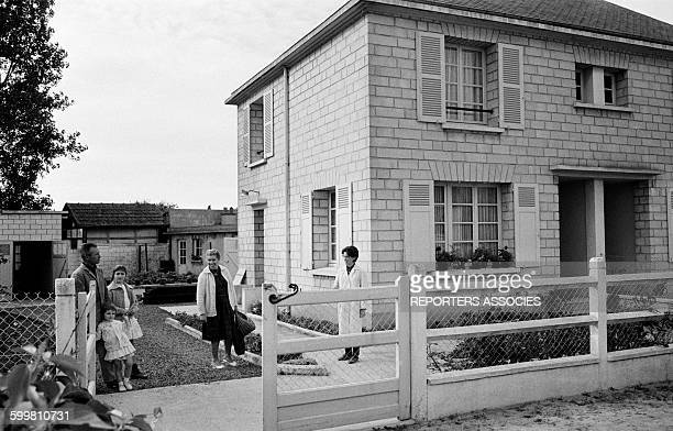 People Talking in the Garden in the Small Norman City of Ouistreham, France, on June 24, 1963 .