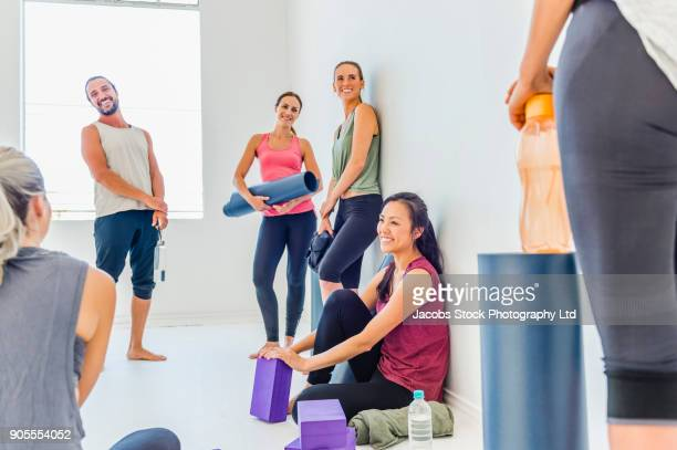 People talking in yoga class